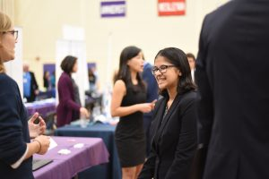 Student interacting with employer at Job & Internship Fair