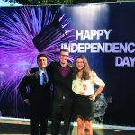 Alexandra and two Marine Security Guards after attending an Embassy-organized Fourth of July Event.