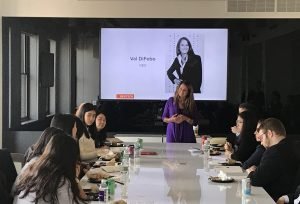 Students hearing from alumna, Val DiFebo '84, on a Media & Communications Career Trek